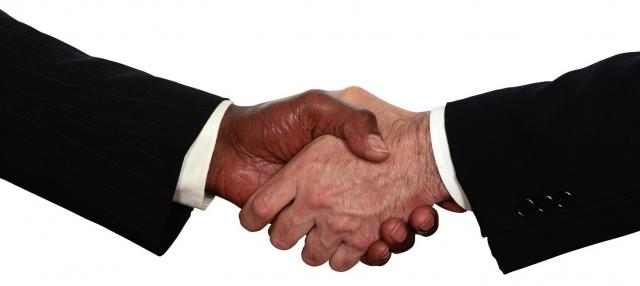 business_men_shaking_hands-e1296983232419.jpg
